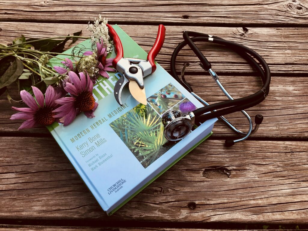 Phyto therapy Modern Herbal Medicine Book with flowers and stethoscope.